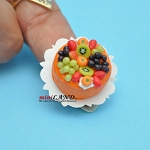 Orange cake decorated with colourful fruit Dollhouse miniatures 1:12
