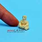 Statue of child sitting cross legged 1:24 scale by J. Killy
